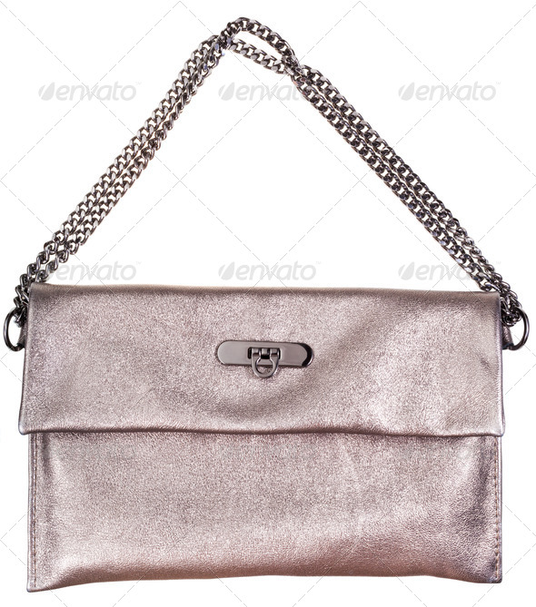 gold leather clutch bag with chain belt - Stock Photo - Images