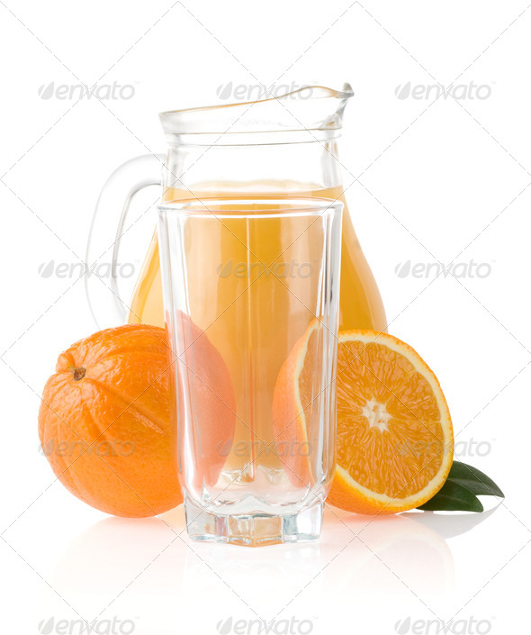 orange fruit and  juice in glass and jug - Stock Photo - Images