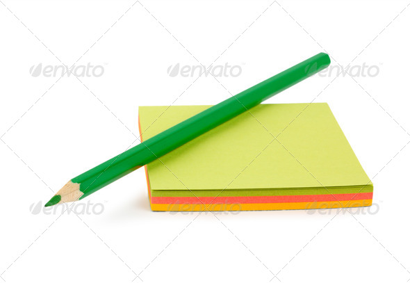 Green pencil on paper - Stock Photo - Images