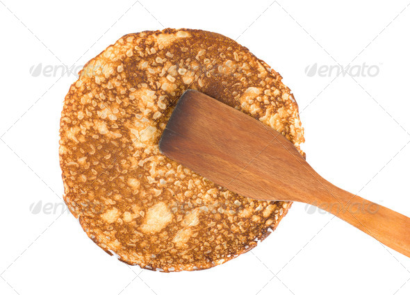 Pancake with a spatula - Stock Photo - Images