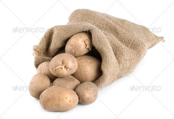 Potatoes in a hessian sack - Stock Photo - Images