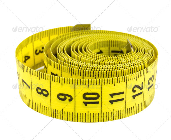 Curled yellow measuring tape - Stock Photo - Images
