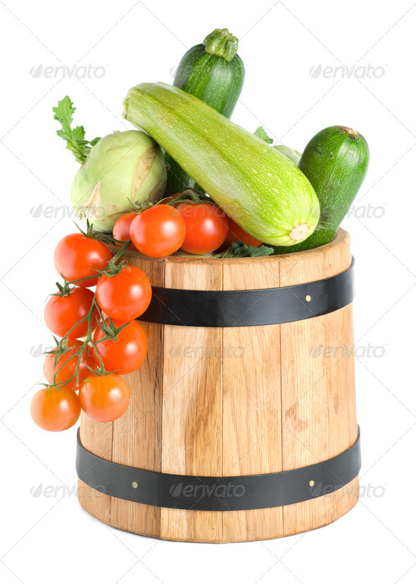 Wooden barrel with vegetables isolated - Stock Photo - Images