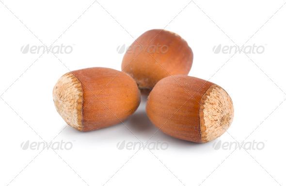Three ripe hazelnuts - Stock Photo - Images