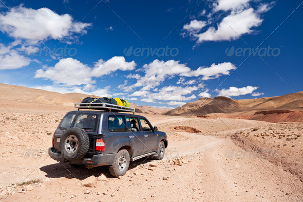 Offroad car in the desert - Stock Photo - Images