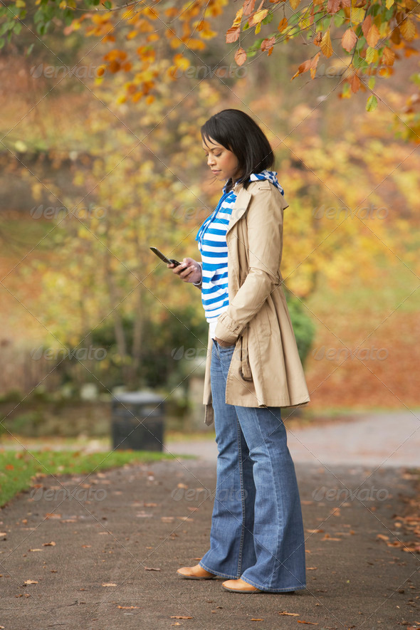 Teenage Girl Making Mobile Phone Call In Autumn Landscape - Stock Photo - Images