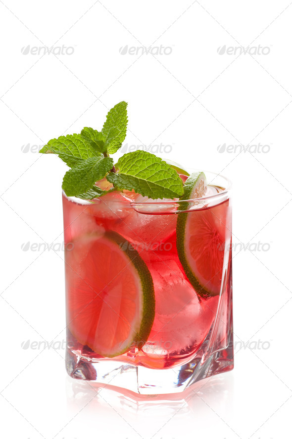 Red alcohol cocktail with lime slices and mint - Stock Photo - Images