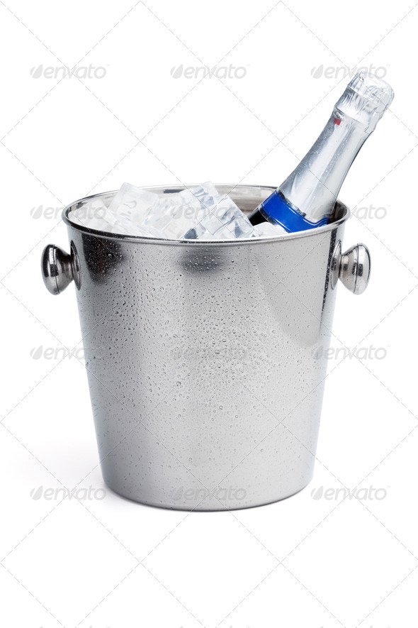 Champagne bottle in ice bucket - Stock Photo - Images