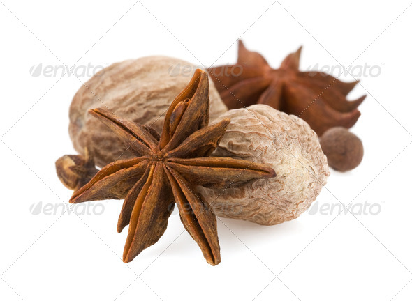 anise star and nutmeg on white - Stock Photo - Images