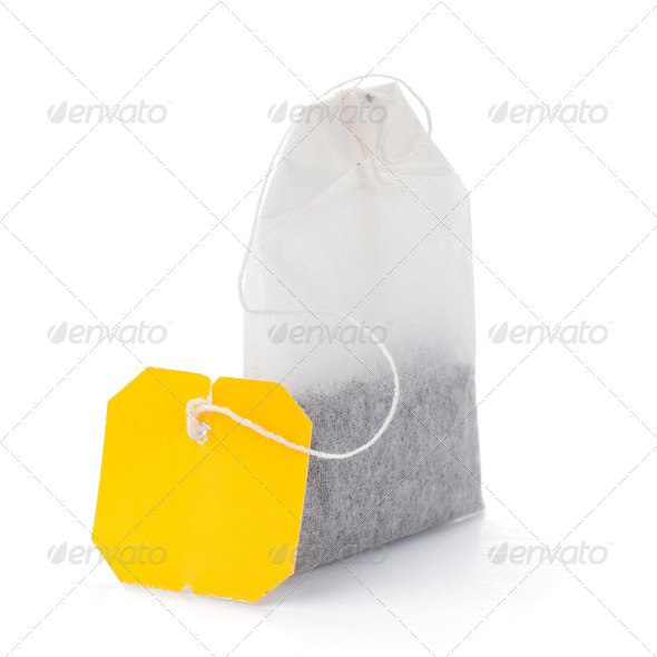 Teabag with yellow label - Stock Photo - Images