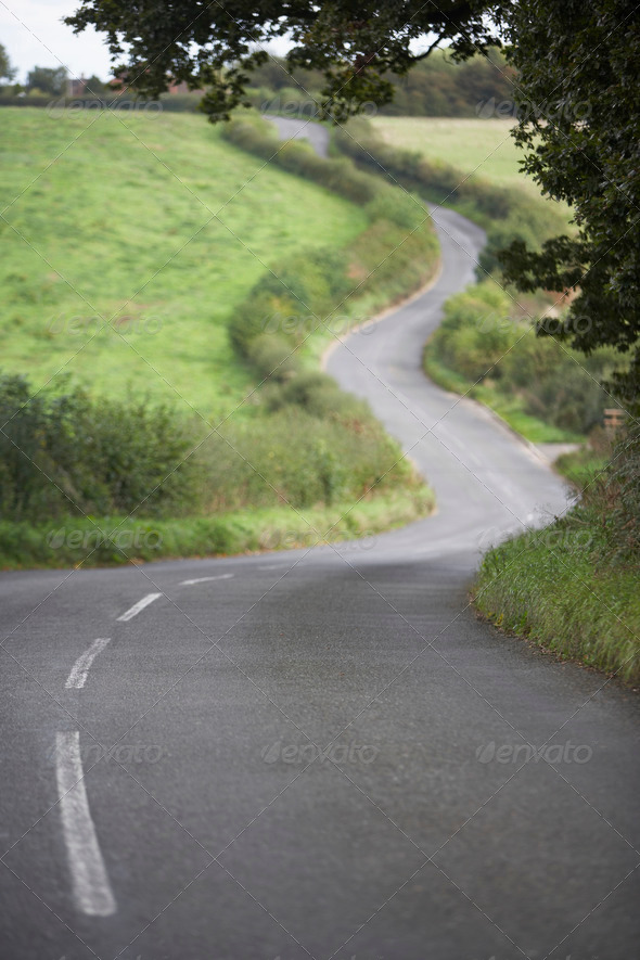 Road Winding Its Way Through The Countryside - Stock Photo - Images