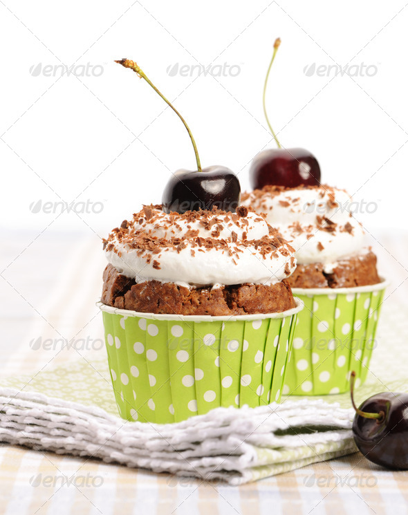 Cupcakes with whipped cream and cherry - Stock Photo - Images