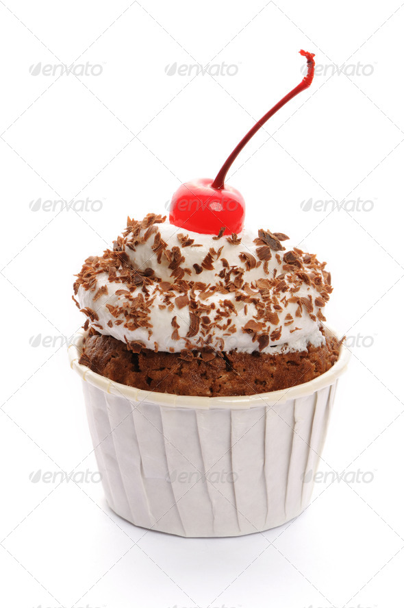 Cupcake with whipped cream and cherry - Stock Photo - Images