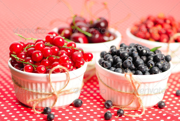 Wild berries in bowls - Stock Photo - Images
