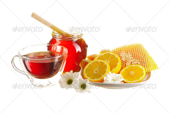 Jar of honey and tea cup - Stock Photo - Images