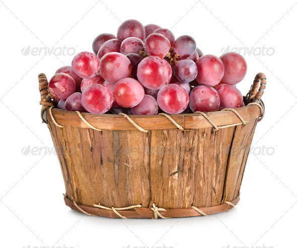 Dark blue grapes in a wooden basket isolated - Stock Photo - Images
