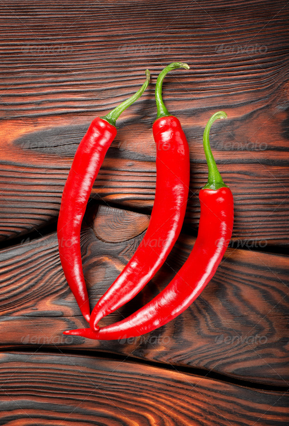 Three red chili peppers - Stock Photo - Images