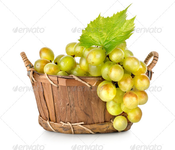 Grapes in a wooden basket isolated - Stock Photo - Images