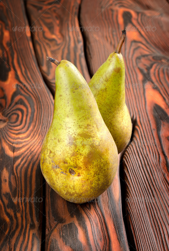 Two pears on an old wooden background - Stock Photo - Images