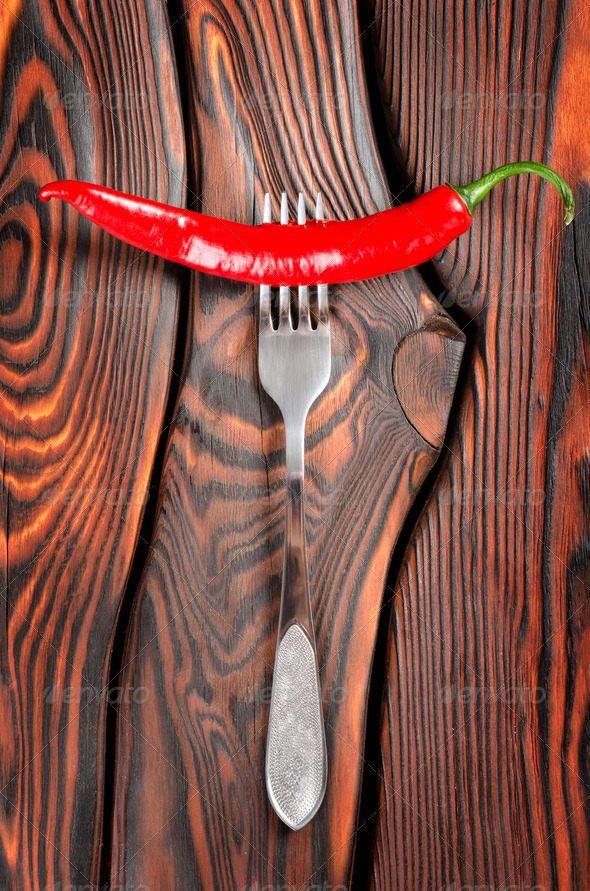 Red chili pepper and fork - Stock Photo - Images
