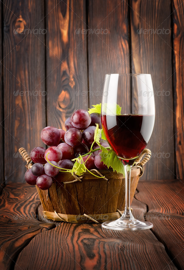 Wine glass and grapes in a basket - Stock Photo - Images