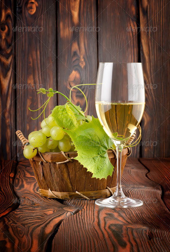 Glass of white wine and grapes - Stock Photo - Images
