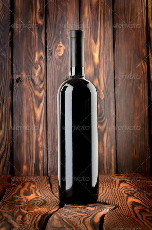 Bottle of red wine on the table - Stock Photo - Images