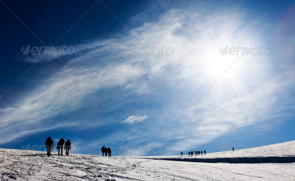 Mountaneers walking on a glacier - Stock Photo - Images