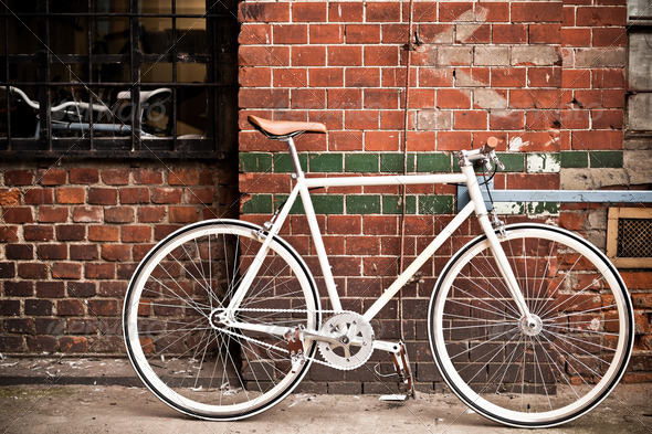 City bicycle on red wall, vintage style - Stock Photo - Images
