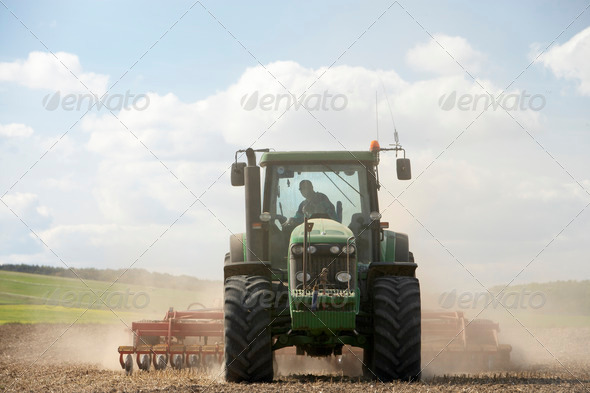 Tractor Preparing Soil - Stock Photo - Images