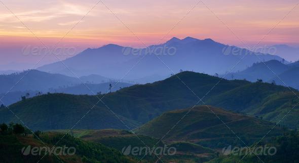 Landscape of sunrise over mountains in Kanchanaburi,Thailand - Stock Photo - Images