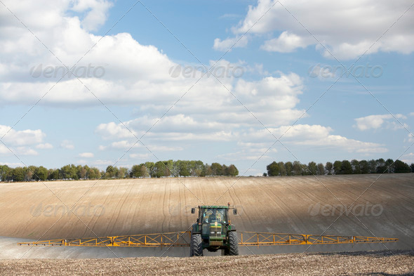 Tractor Spraying Field - Stock Photo - Images