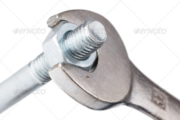 chrome spanner with nut and bolt - Stock Photo - Images