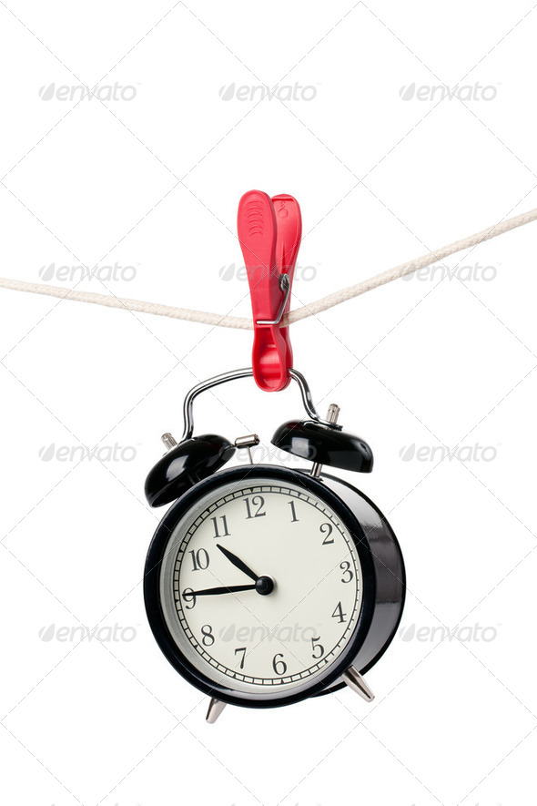 alarm clock on the clothesline - Stock Photo - Images