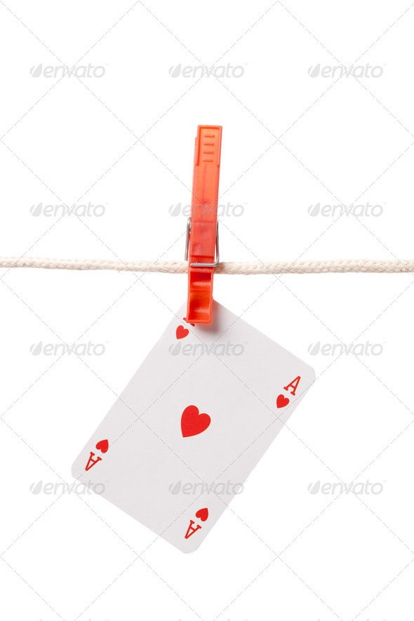 ace hanging on clothesline - Stock Photo - Images