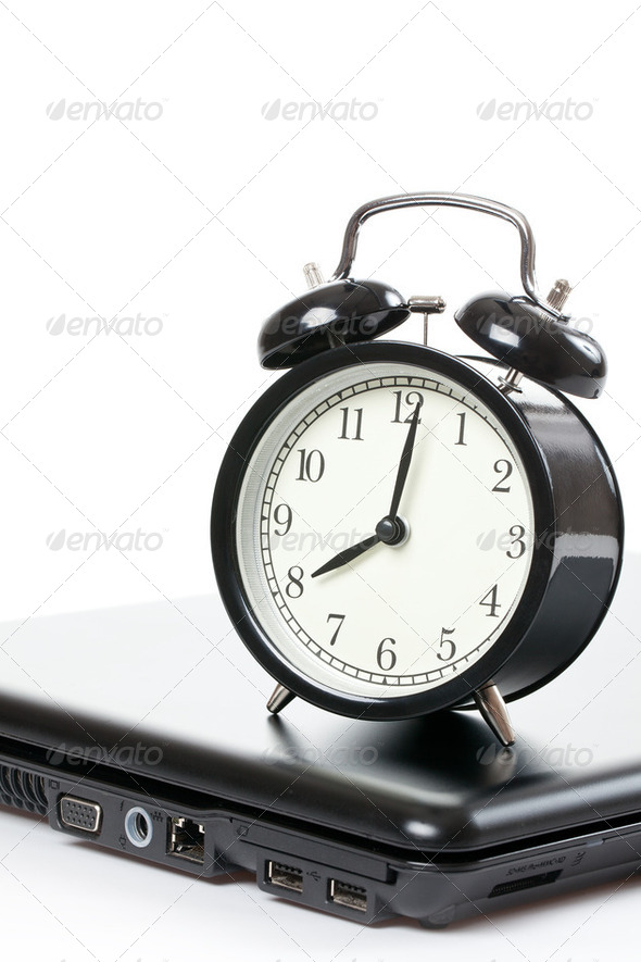 alarm clock and laptop - Stock Photo - Images