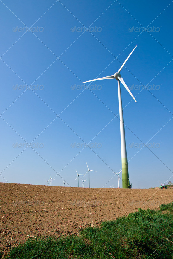 Windwheel and a barren field - Stock Photo - Images