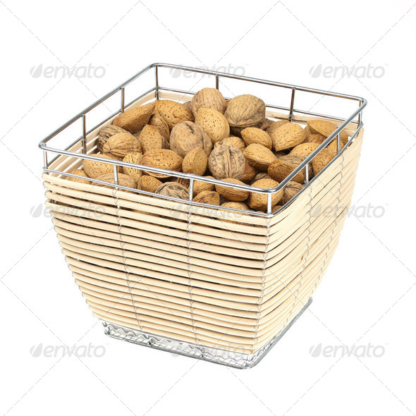 Almonds and walnuts in a food basket isolated on white - Stock Photo - Images