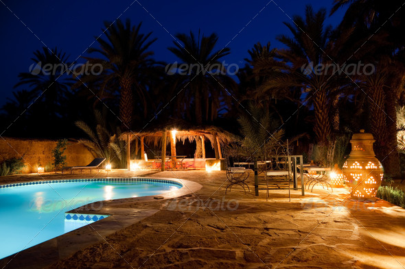 Arab hotel pool evening - Stock Photo - Images