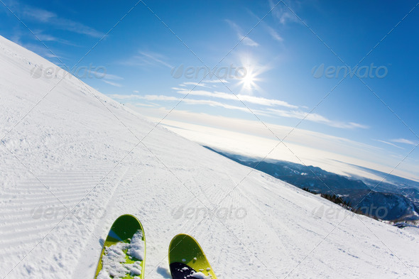 Skiing on a ski slope - Stock Photo - Images