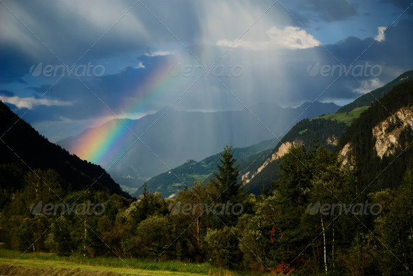 Rainbow in the Alps - Stock Photo - Images