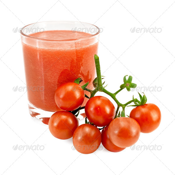 Juice tomato in a glass and a bunch of tomatoes - Stock Photo - Images