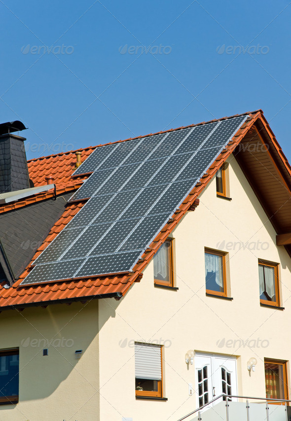 Roof with solar panels in Germany - Stock Photo - Images
