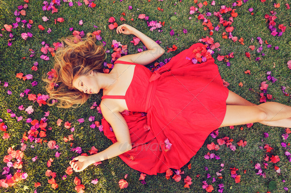 Beautiful Young Woman Lying in Flowers - Stock Photo - Images