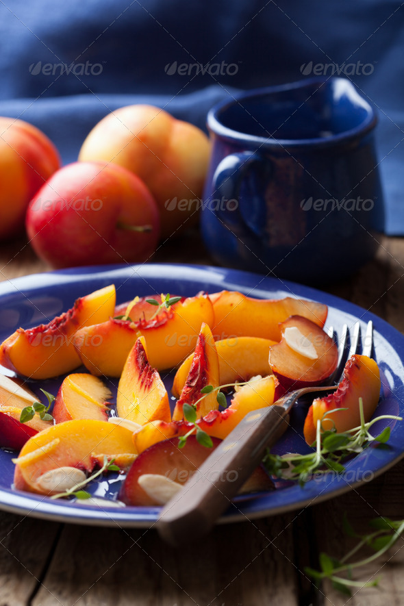 nectarines and plums in syrup - Stock Photo - Images