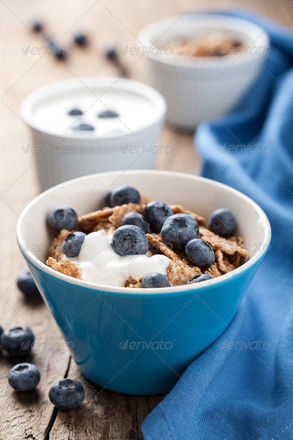 cornflakes with blueberry and yogurt - Stock Photo - Images