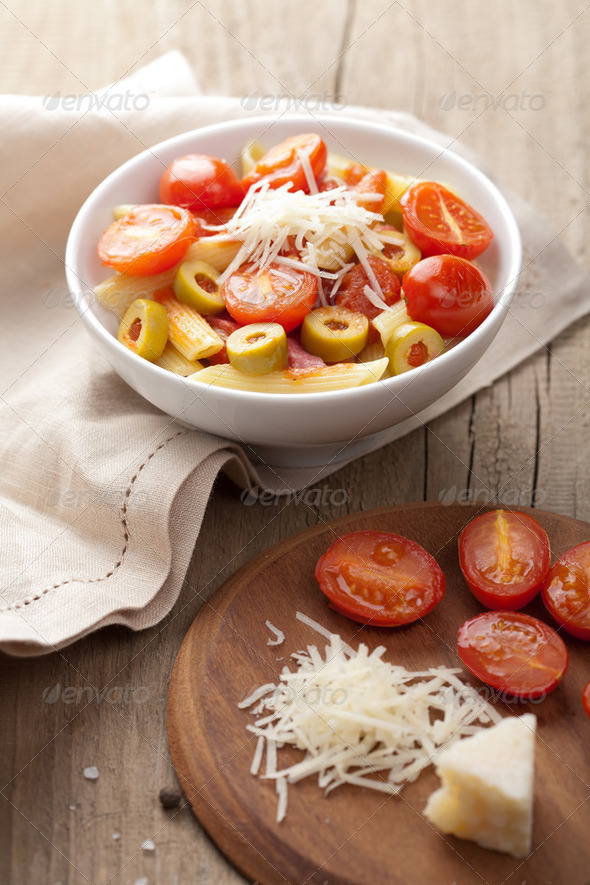 pasta with tomatoes and salami - Stock Photo - Images