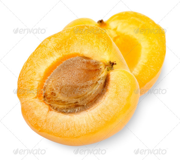 Ripe apricot sectioned by knife - Stock Photo - Images