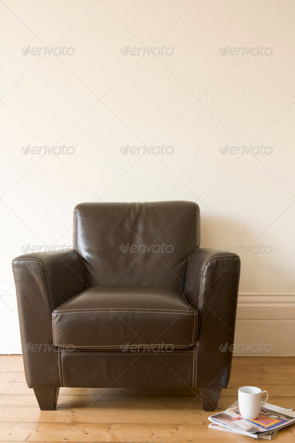 Chair with coffee mug and magazine beside it - Stock Photo - Images