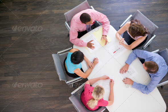 Five businesspeople at boardroom table - Stock Photo - Images